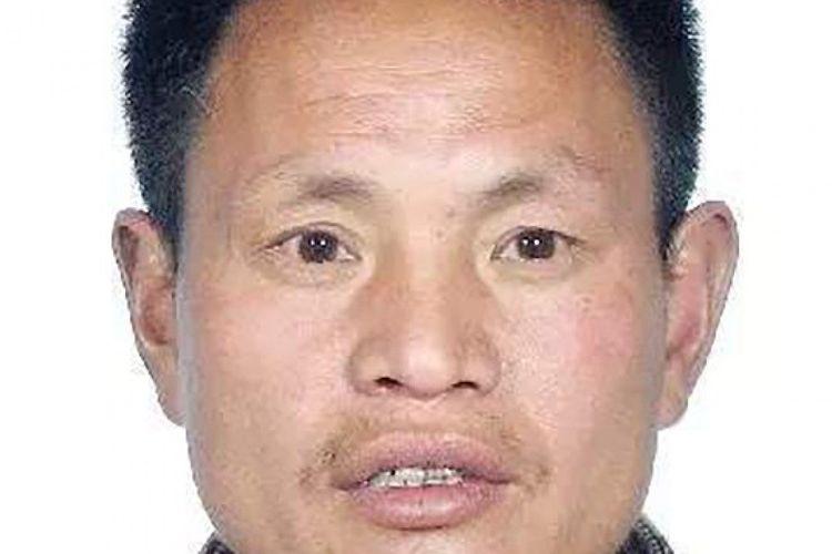 Zhang Juqian. Seorang pembunuh berantai yang menjadi buruan polisi karena membunuh lima orang pada pekan lalu.