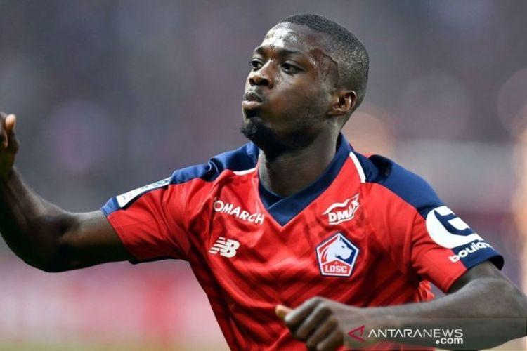 Striker Lille, Nicolas Pepe, dikabarkan akan segera berbaju Arsenal.