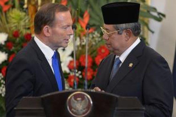 PM Tony Abbott dan Presiden Susilo Bambang Yudhoyono usai jumpa pers di Istana Negara, Jakarta, Senin (30/9/2013).