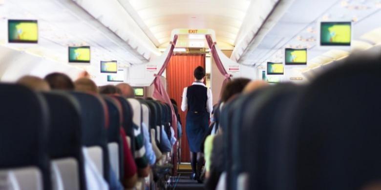 Ilustrasi kabin penumpang di pesawat terbang.