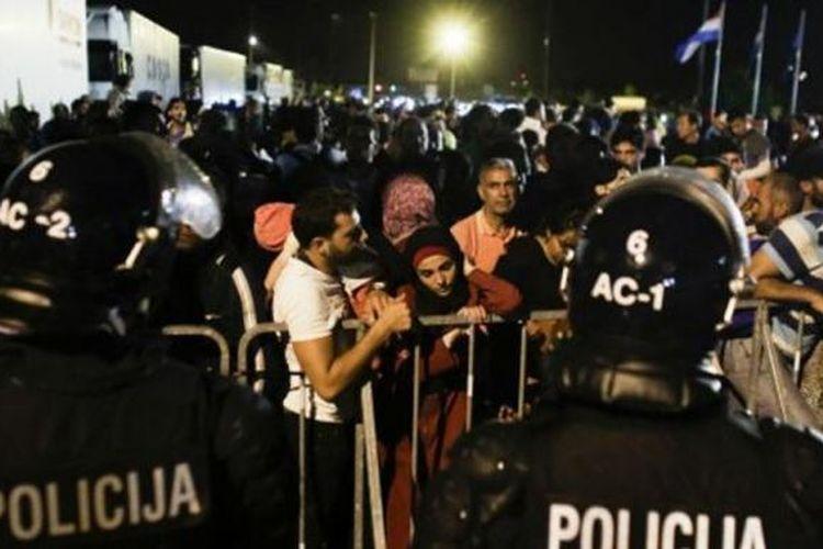 Para pendatang saat berada di perbatasan Kroasia dari Slovenia.