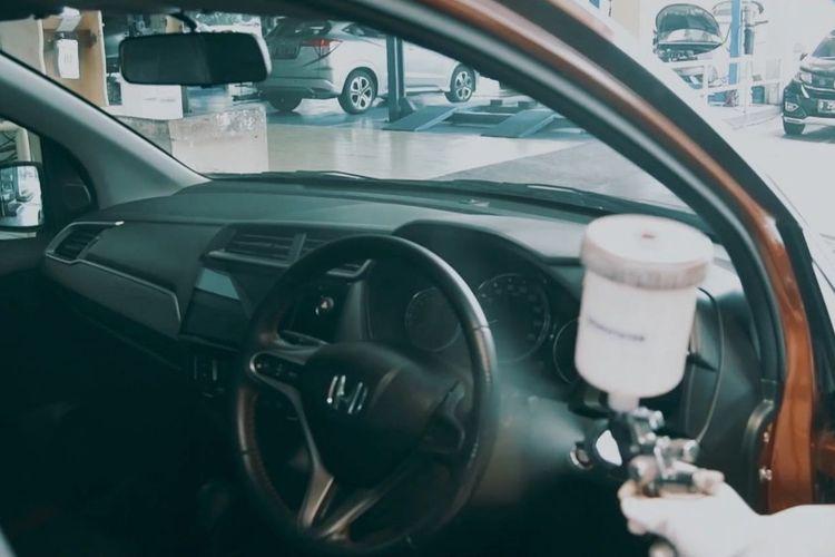 Ilustrasi bengkel mobil di diler Honda Megatama