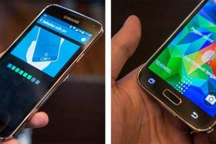 Pemindai sidik jari pada Galaxy S5 mengharuskan pengguna menyapukan jari secara vertikal