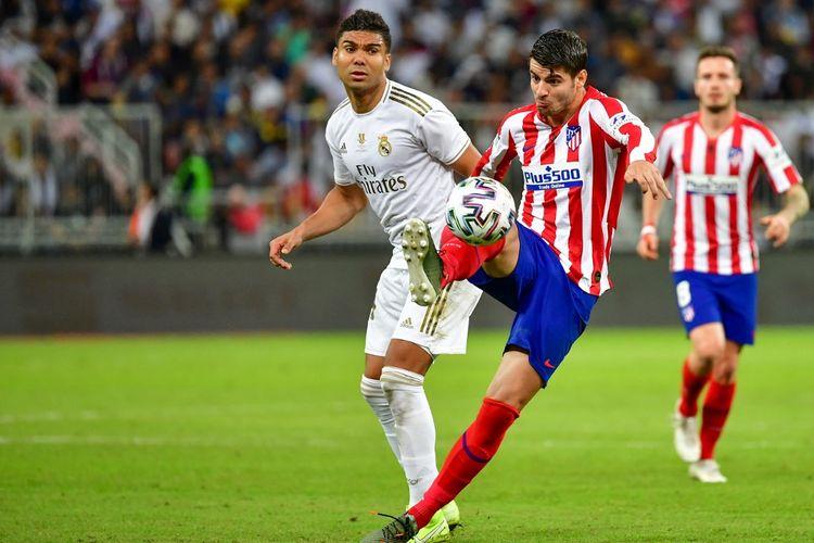 Casemiro dan Alvaro Morata pada laga Real Madrid vs Atletico Madrid di Piala Super Spanyol, Senin (13/1/2020).