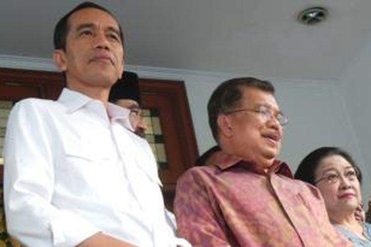Presiden terpilih, Joko Widodo bersama wakil presiden terpilih, Jusuf Kalla dan Ketua Umum PDI-P, Megawati Soekarno Putri.