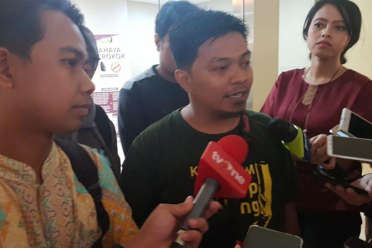 Ketua Divisi Bidang Advokasi AJI Jakarta Erick Tanjung saat datang ke Bareskrim Polri, Rabu (9/10/2019).