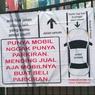Viral, Foto Spanduk Sindiran Untuk Warga yang Parkir Mobil di Jalan