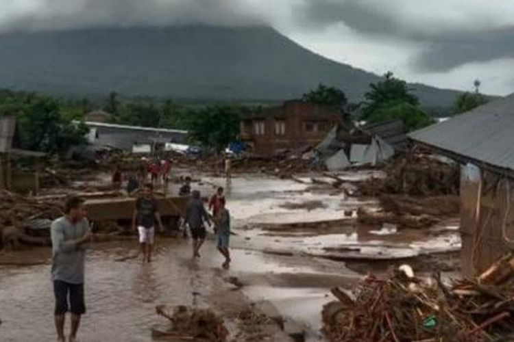 A flood destroys houses and inundated streets in Waiwerang, East Flores regency in the Indonesian region of East Nusa Tenggara on Sunday, April 4, 2021.