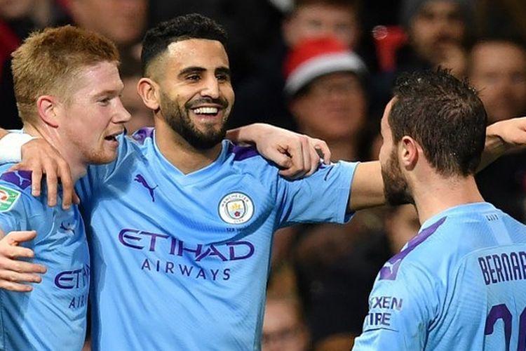 Pemain Manchester City merayakan gol ke gawang Manchester United dalam leg pertama semifinal Piala Liga Inggris, Selasa (7/1/2020) atau Rabu dini hari WIB.