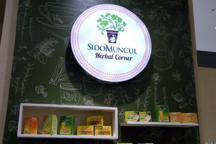 Logo Sido Muncul Herbal Corner Mal Aeon Bumi Serpong Damai (BSD), Tangerang Selatan. Menurut Direktur Marketing PT Sido Muncul Tbk Irwan Hidayat, pihak Mal Aeon yang kali pertama menginginkan adanya gerai minuman herbal di dalam mal tersebut. Mal Aeon di bawah AEON Group berbasis di Jepang.