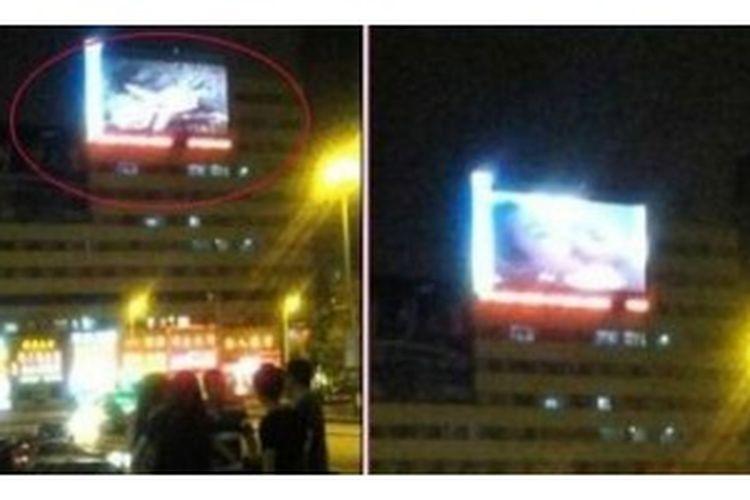 Video porno yang diputar di billboard digital stasiun kereta Jilin City, China