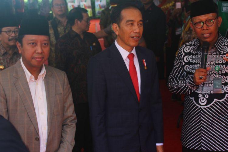 Ketua Umum PPP Muhammad Romahurmuziy saat mendampingi Presiden Joko Widodo di Universitas Islam Malang (Unisma) Kamis (29/3/2018)