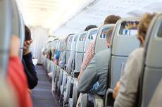 Seorang Wanita Diturunkan dari Pesawat Gara-gara Tulisan di Maskernya