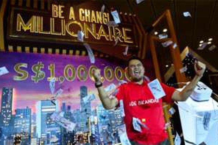 Ade Iskandar Roni menjadi miliarder dadakan usai memenangkan 1 juta dollar Singapura (Rp 9,3 miliar) dari lucky draw di Bandara Changi.