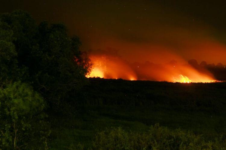Kebakaran hutan dan lahan yang melanda Sumatera Selatan mengakibatkan kabut asap tebal menyelimuti kota Palembang.