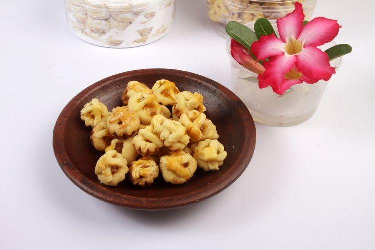Ilustrasi nastar, kue khas Lebaran di Indonesia. Bentuk nastar cukup beragam, salah satunya jaring-jaring serupa apple pie.
