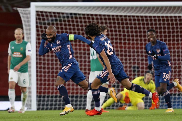 Selebrasi stiker Arsenal Alexandre Lacazette usai membobol gawang Rapid Wina pada laga matchday 5 Grup B Liga Europa 2020-2021 di Stadion Emirates, Kamis (3/12/2020) atau Jumat dini hari WIB. Arsenal keluar sebegai pemenang dalam laga tersebut dengan skor 4-1.