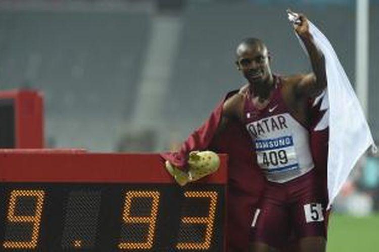 pelatih Qatar, Femi Seun Ogunode, berpose setelah menyelesaikan lari 100 meter Asian Games 2014 di Incheon, Korea Selatan, Minggu (28/9/2014).