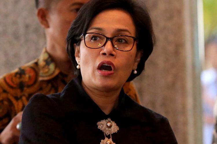 Menteri Keuangan Sri Mulyani tiba di Bursa Efek Indonesia (BEI), Jakarta, Selasa (4/7/2017). Kedatangan Presiden Joko Widodo dalam rangka kunjungan kerja dan dialog ekonomi dengan para pelaku pasar modal.