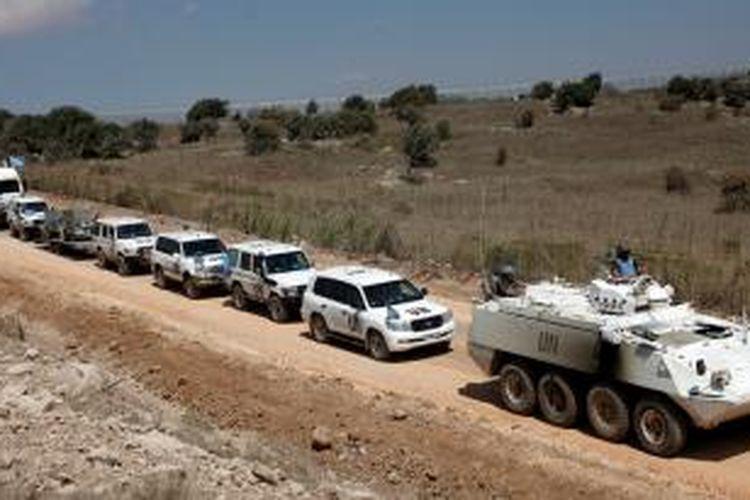Pasukan penjaga perdamaian PBB di Dataran Tinggi Golan (UNDOF) meninggalkan sisi Suriah dataran strategis itu menuju ke sisi yang diduduki Israel.