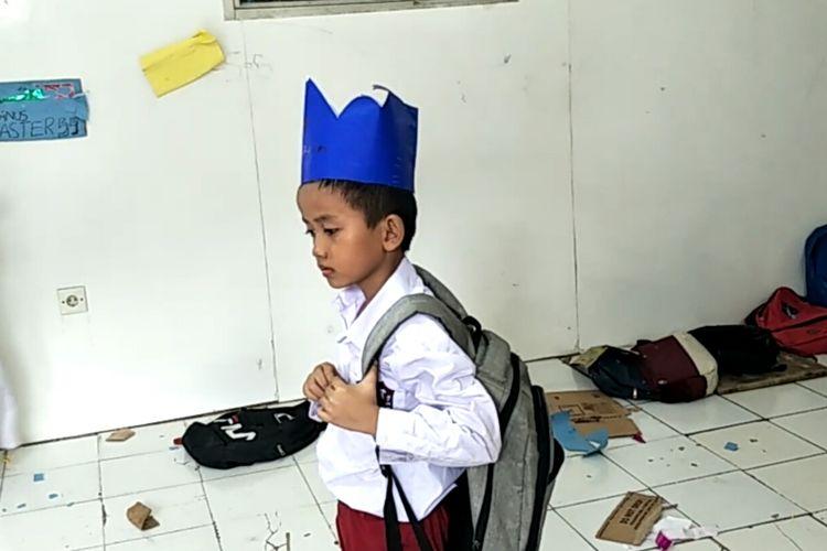 Karim (10), murid sekolah Master di Sekolah Master Indonesia, Jalan Arif Rahman Hakim, Depok, Selasa (30/4/2019).