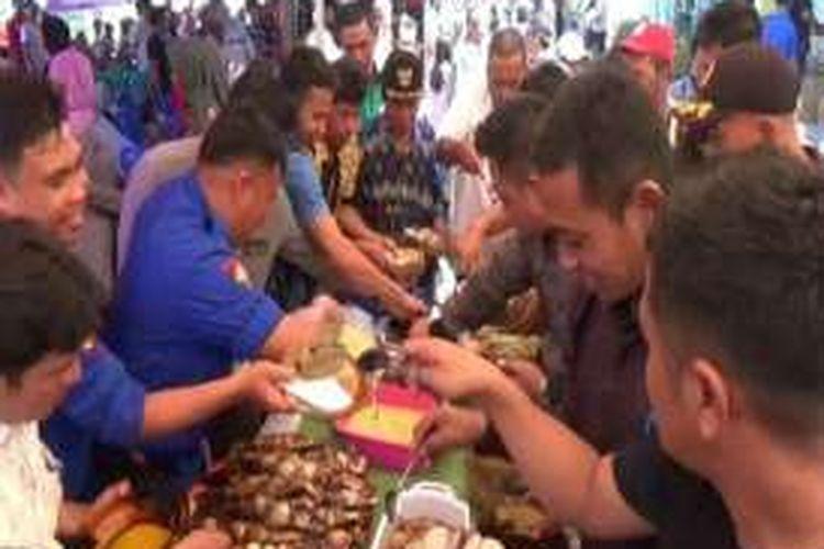 Momentum peringatan Hari Ikan Nasional, Nelayan Polewali Mandar sulawesi barat Pesta Makan Ikan Hingga Mendapat Premi Asuransi  Nelayan