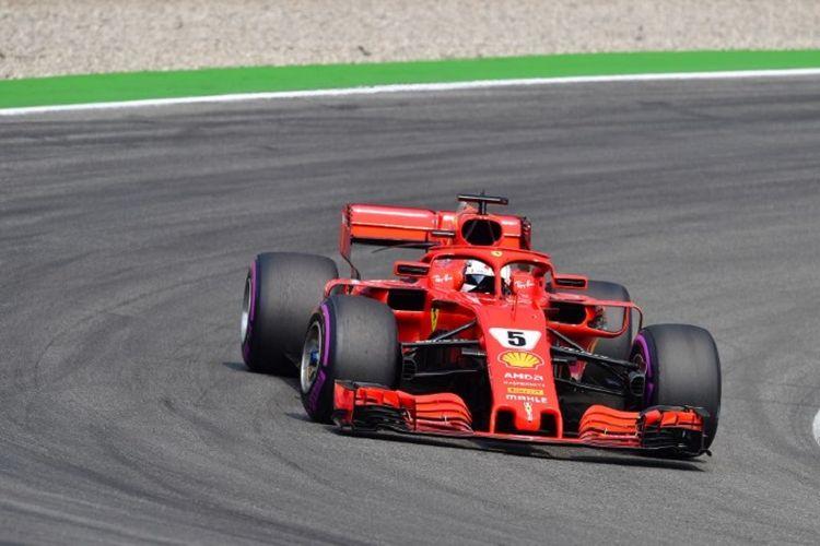 Pebalap Ferrari, Sebastian Vettel, saat menjalani balapan GP Jerman di Hockenheimring, Minggu (22/7/2018).