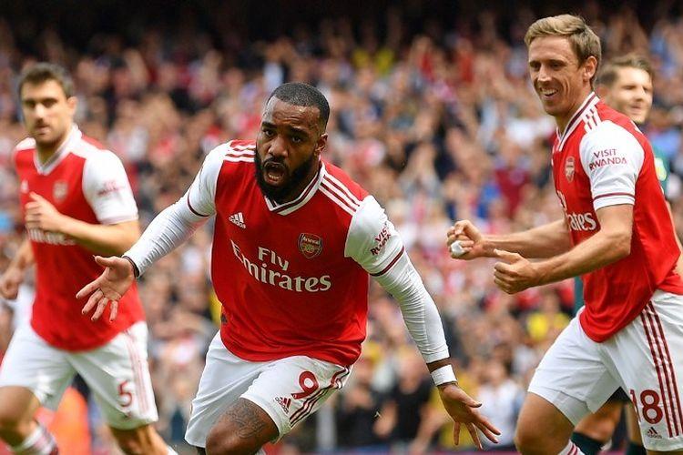 Alexandre Lacazette merayakan golnya pada pertandingan Arsenal vs Burnley di Stadion Emirates dalam lanjutan Liga Inggris, 17 Agustus 2019.