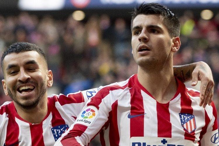 Alvaro Morata (kanan) merayakan gol bersama Angel Correa (kiri) pada laga Atletico Madrid Vs Espanyol dalam lanjutan pekan ke-13 Liga Spanyol di Stadion Wanda Metropolitano, Minggu 10 November 2019.