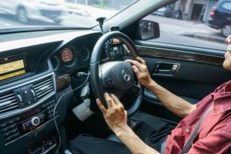 Pengemudi mobil Uber yang ditumpangi Kompas Tekno, Iwan Setiawan