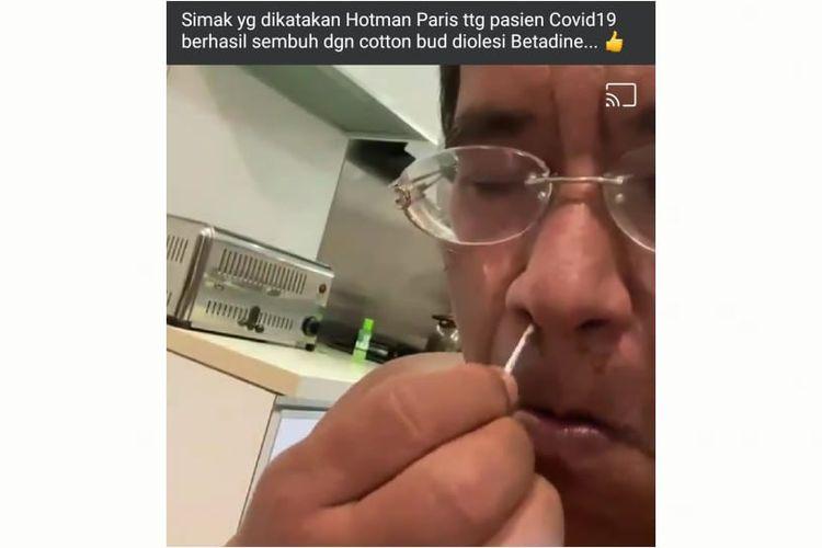 Status Facebook yang mengunggah video dengan klaim mengoleskan Betadine ke dalam lubang hidung dapat menyembuhkan Covid-19.