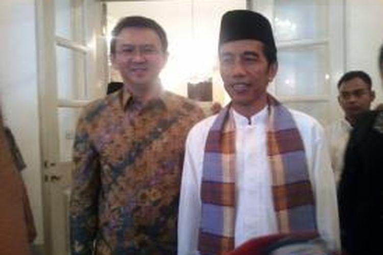 Gubernur DKI Jakarta Joko Widodo dan Wakil Gubernur Basuki Tjahja Purnama pada silaturahim Idul Fitri 1434 H di Balaikota, Kamis (8/8/2013).
