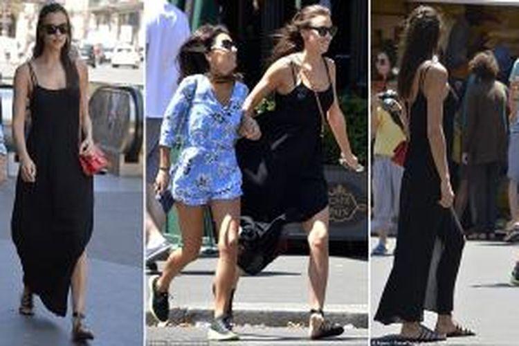 Mengenakan gaun panjang warna hitam, Irina Shayk asik berjalan-jalan dengan seorang teman wanita di Paris