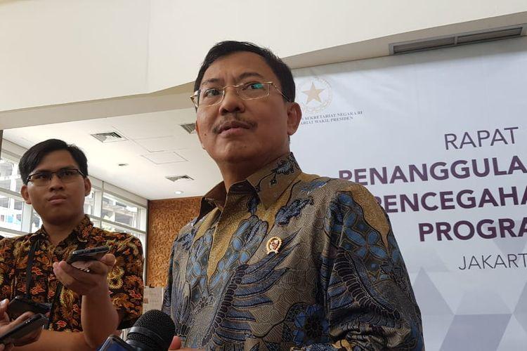 Menteri Kesehatan Terawan Agus Putranto usai melaksanakan rapat TNP2K di Kantor TNP2K, Jalan Kebon Sirih, Jakarta Pusat, Selasa (11/2/2020).