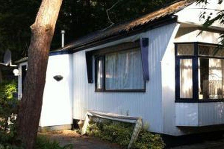Stacaravan di Zonnenland - Nispen, sebuah kawasan hijau seluas 15 hektar terletak di daerah perbatasan antara Belgia dan Belanda.