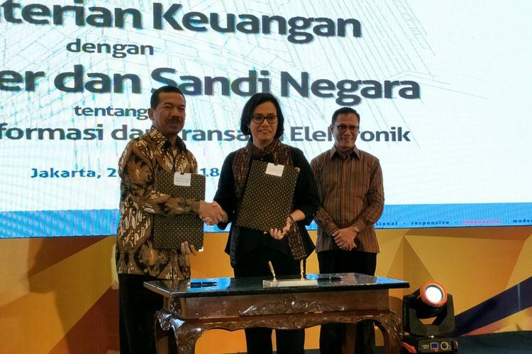 Menteri Keuangan Sri Mulyani, Kepada BPS Suhariyanto, dan Kepala BSSN Djoko Setiadi saat penandatanganan Memorandum of Understanding(MoU) di Kementerian Keuangan, Jakarta, Jumat (2/3/2018).