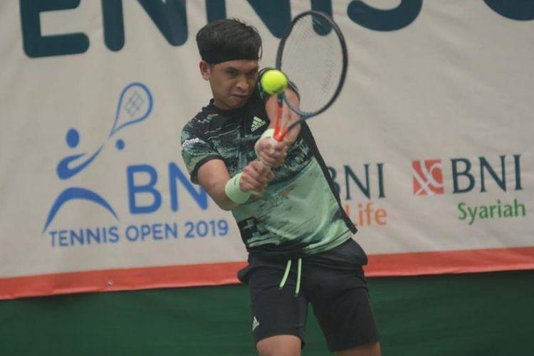 Christopher Rungkat, petenis putra andalan timnas Indonesia pada SEA Games 2019. Christopher Rungkat menjadi juara tunggal putra turnamen  BNI Tennis Open 2019 pada Jumat (22/11/2019)