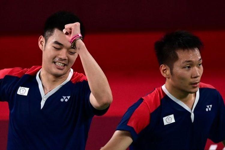 Ganda putra Taiwan Lee Yang/Wang Chi-lin setelah menang atas wakil Jepang dan memastikan tiket semifinal badminton Olimpiade Tokyo 2020.