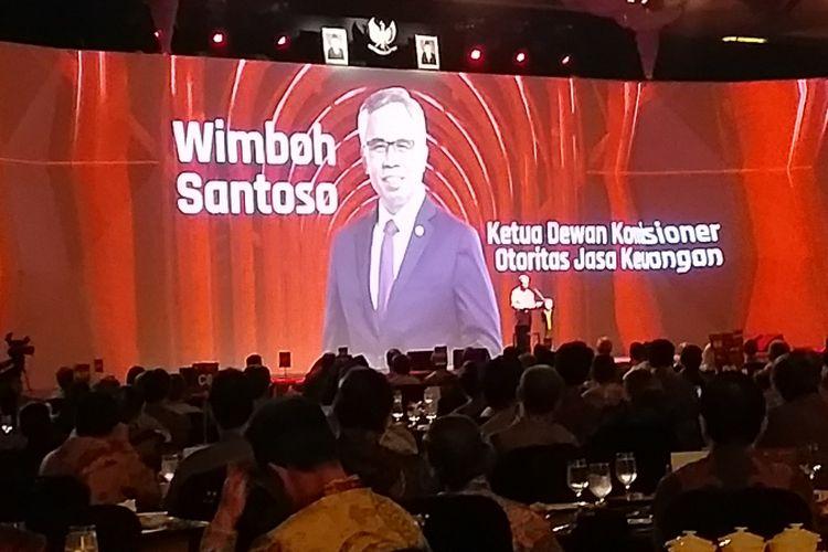 Ketua Dewan Komisioner OJK Wimboh Santoso saat memberi paparan kinerja OJK selama 2018 dalam Pertemuan Tahunan Industri Jasa Keuangan di Jakarta, Jumat (11/1/2019).