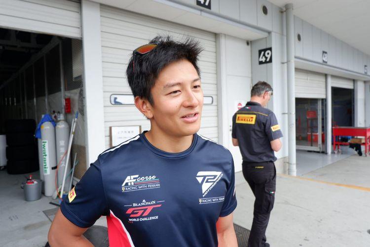 Pebalap Indonesia dari tim T2 Motorsports, Rio Haryanto, berbincang usai balapan kedua seri ketiga Blancpain GT World Challenge Asia 2019, di Sirkuit Suzuka, Jepang, Minggu (23/6/2019).