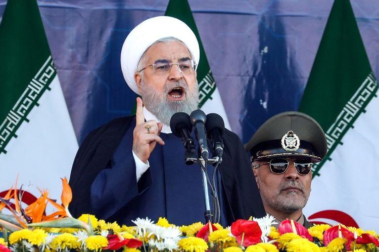 Presiden Iran Hassan Rouhani saat berpidato dalam gelaran parade militer di Teheran, Sabtu (22/9/2018).