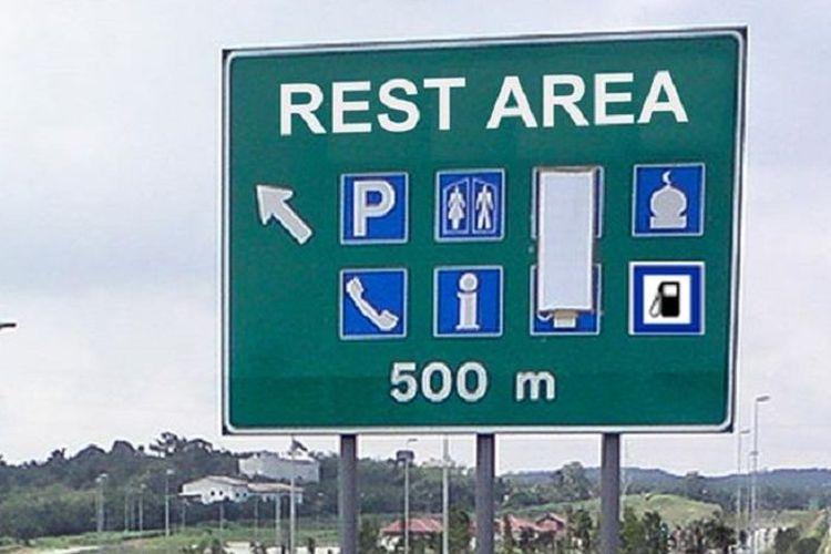 Ilustrasi papan penunjuk arah ke rest area.