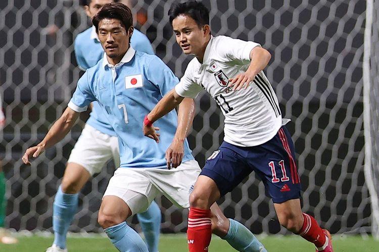 Aksi pemain timnas U24 Jepang Takefusa Kubo pada laga kontra timnas senior Jepang di Sapporo Dome, Sapporo, pada 3 Juni 2021.
