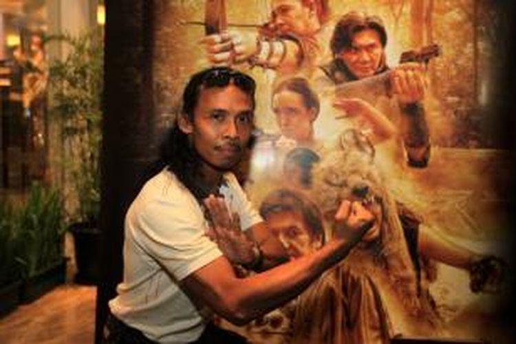 Yayan Ruhian berpose saat peluncuran trailer film Comic 8: Casino Kings di Kemang Village XXI, Jakarta, Rabu (15/4/2015).
