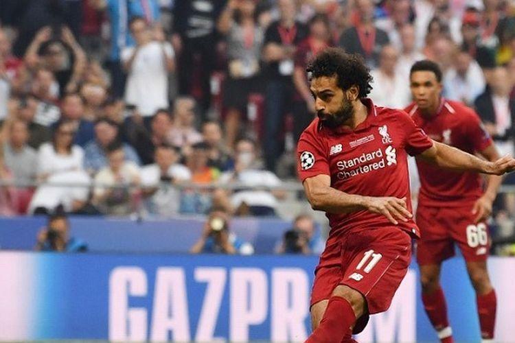 Penyerang Liverpool, Mohamed Salah, mengeksekusi tendangan penalti pada pertandingan final Liga Champions antara Liverpool vs Tottenham Hotspur di Stadion Wanda Metropolitano di Madrid pada 1 Juni 2019.