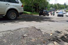 Jalan Boulevard Grand Depok City Rusak dan Rawan Kecelakaan