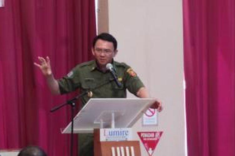 Wakil Gubernur DKI Jakarta Basuki Tjahaja Purnama saat memberikan sambutan di rembuk provinsi, Jakarta, Senin (2/12/2013).