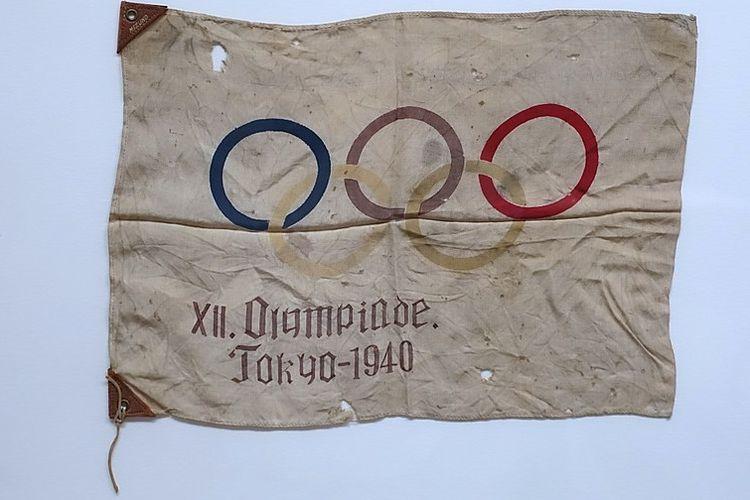 Bendera Olimpiade Tokyo 1940 yang batal bergulir. Pada Selasa (24/3/2020) dini hari WIB, Olimpiade Tokyo 2020 dilaporkan bakal dibatalkan, pertama kali Olimpiade ditunda sejak Perang Dunia Kedua.