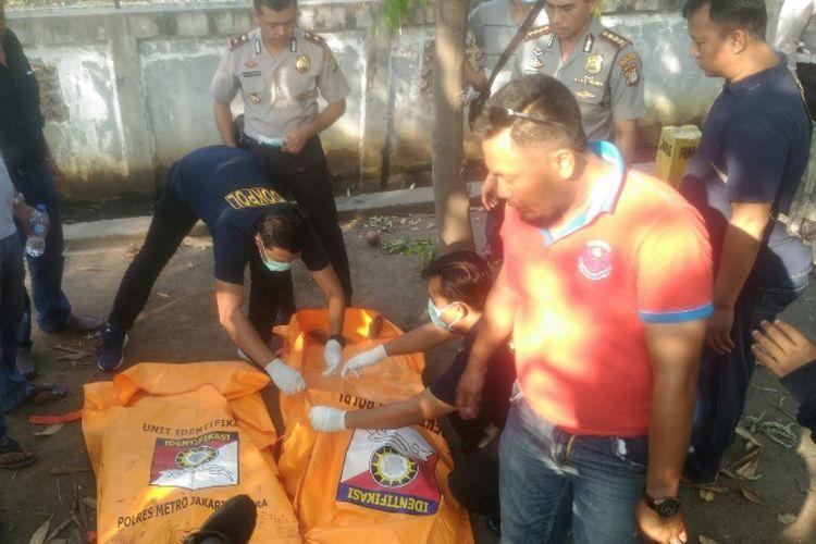 Polres Metro Jakarta Utara meringkus lima perampok anggota kelompok Bad Boy di Jalan Raya Cakung-Cilincing, Kamis (10/8/2017). Dua tersangka ditembak mati di lokasi dan tiga lainnya luka-luka.
