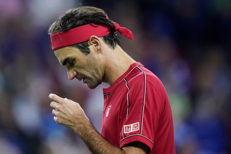 Tennis - Shanghai Masters - Mens Singles - Quarterfinals - Qi Zhong Tennis Center, Shanghai, China - October 11, 2019. Roger Federer of Switzerland reacts during his match against Alexander Zverev of Germany.  REUTERS/Aly Song